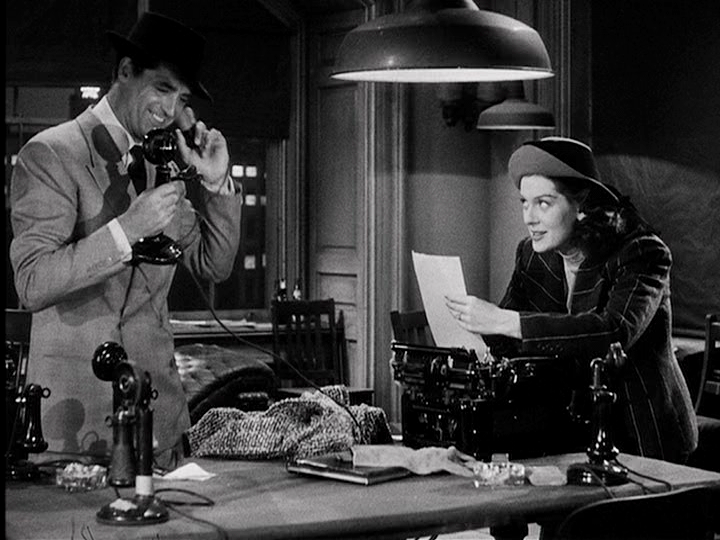 """Cary Grant and Rosalind Russell in the classic newspaper comedy, """"His Girl Friday"""""""