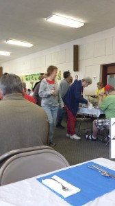 Parishioners mingle in the social hall.