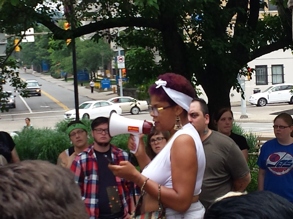 Joy KMT addressing the march Photo: Sue Kerr