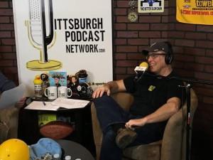 John recording his podcast