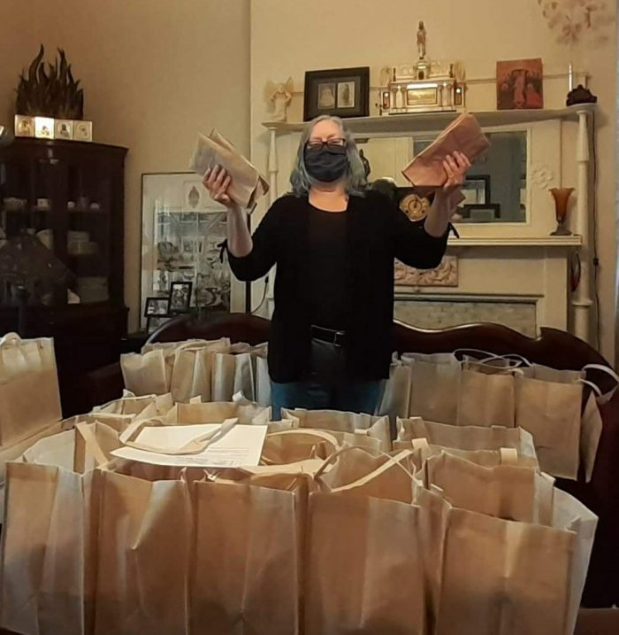 Packing face masks to give to the community
